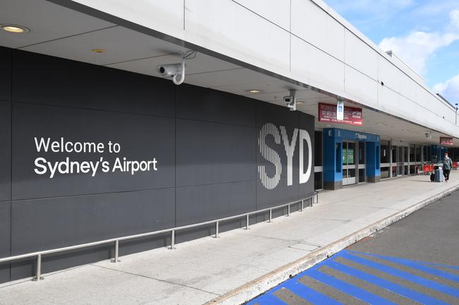 A quiet departures forecourt outside the International Terminal at Kingsford Smith Airport.