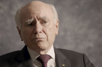 John Howard says he backed his then-tourism minister.