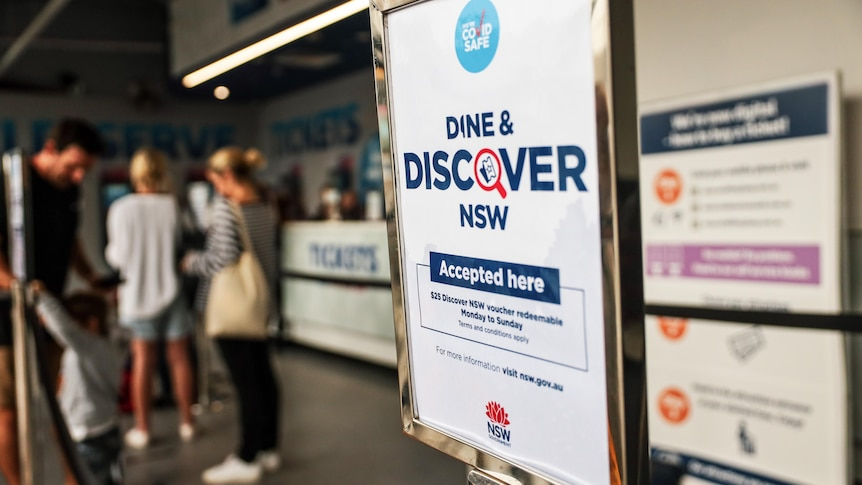 A sign that reads dine and discover.